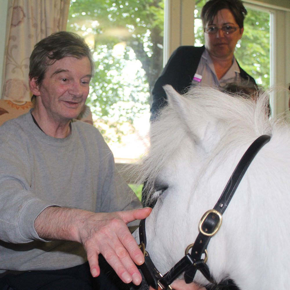 Resident with a pony