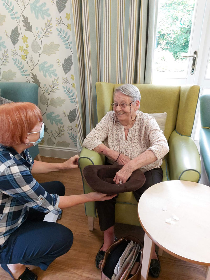 Sonnet Care Homes CEO Julia Clinton invites resident Doreen Frost to draw the names out of a hat