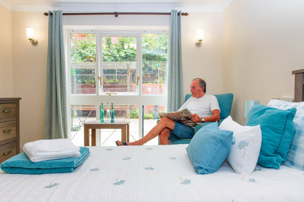 Relaxing at St Mary's Court in bedroom in our Care home in Braintree, Essex